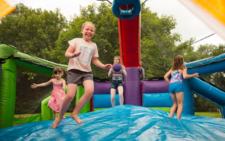 fun bouncing house at Long Lake Area Chamber event